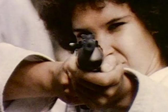 Still from Born in Flames, person pointing gun