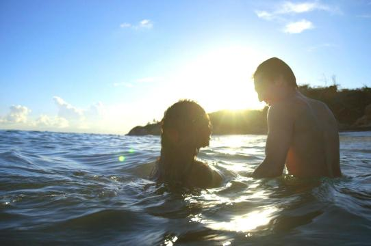 Image of two people in the ocean
